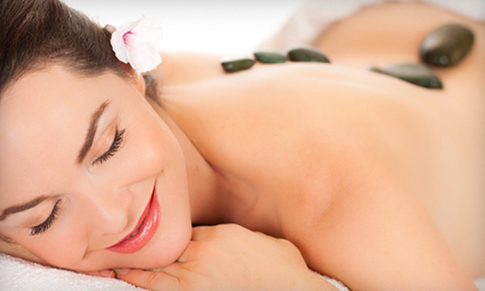 Touch of Class Day Spa - Coral Springs: $129 for a Hot-Stone Massage, Reflexology, Facial, and Body Wrap, Plus Wine at Touch of Class Day Spa (Up to $305 Value)