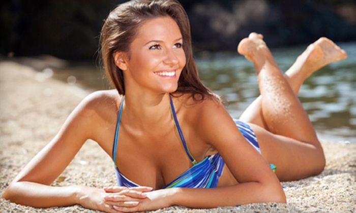Solar Dimensions - Multiple Locations: One or Three Spray or UV Tans or One Custom-Blended Airbrush Tan at Solar Dimensions (Up to 68% Off)