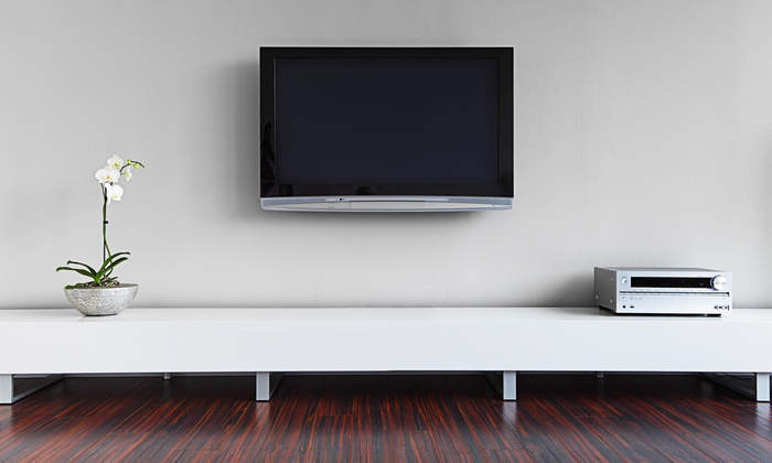 Music Evolution - Evolution Installs - Chicago: $299 for TV Wall-Mounting with Tilt Bracket and Wire-Concealment from Music Evolution - Evolution Installs ($650 Value)
