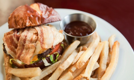 $11 for Two Groupons, Each Good for $10 Worth of Pub Food at The Tipping Cow Inside Moriarty's Pub & Grille ($20 Value)