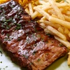 $8 for Burgers and Baby Back Ribs at Alfie's Inn