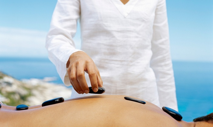 Axis Natural Medicine - Fort Myers: 60-Minute Swedish or Hot-Stone Massage at Axis Natural Medicine (Up to 53% Off)