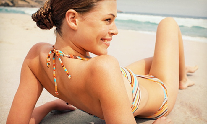 Urban Tan - Multiple Locations: One Month of Unlimited Bed Tanning or One or Three Spray Tans at Urban Tan (Up to 53% Off)