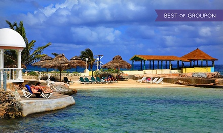 groupon daily deal - Stay at All-Inclusive Club Ambiance in Runaway Bay, Jamaica. Dates into July. Includes Taxes and Fees.