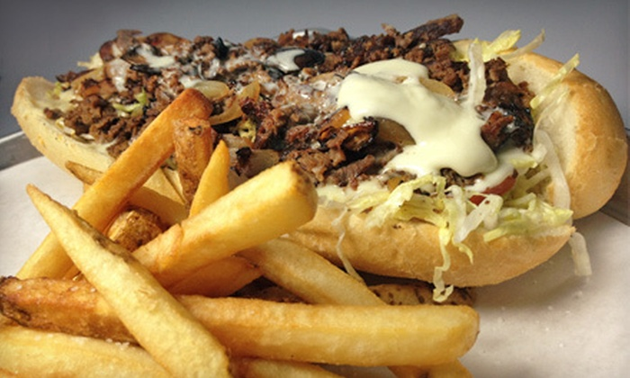Monti's - Lincoln Square: 8-Inch Authentic Philly Cheesesteak with Fries or Salads, Desserts, and Beers for Two or Four at Monti's (Up to 54% Off)