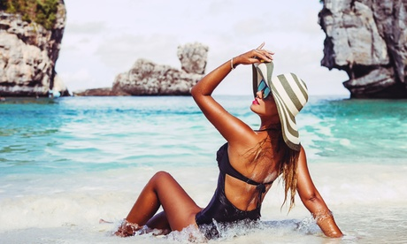 3 Spray-Tan Sessions or 1 Month of Unlimited UV-Tanning Sessions at South Beach Tanning Company (Up to 70% Off)