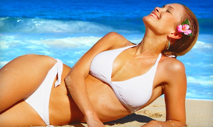 Totally Tan - Ramsey: Two or Four Mystic Tan Spray Tans or Three or Six Sessions in a High-Level UV Bed (Up to 75% Off)