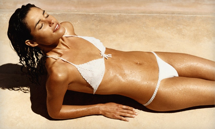 TNT Tanning - Multiple Locations: One Spray Tan, One Month of Unlimited UV Tanning, or Two Fit Body Wraps at TNT Tanning (Up to 72% Off)