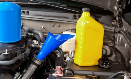 Inspection and Emissions Test or Oil Change and Tire Rotation at Plymouth Auto & Tire Center (Up to 56% Off)