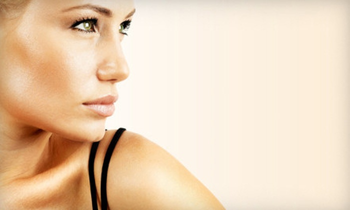 J2 Tanning - Multiple Locations: One Spray Tan, One Month of UV Tanning, or Three Months of Red-Light Therapy at J2 Tanning (Up to 60% Off)
