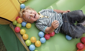 Jungle George's: Bounce-House Admission for Up to Two or Five Kids with Tokens and Snacks at Jungle George's (Up to 52% Off)