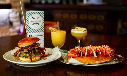 image for Hot Dog or Burger with a Cocktail for Two or Four at The Whistle Stop Barber Shop Bar and Diner (Up to 52% Off)