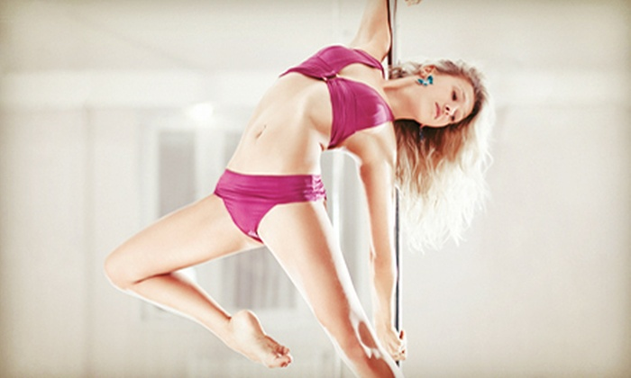 World of Pole - Garden City: One Month of Unlimited P90X Fitness Classes or Four Intro Pole Classes at World of Pole (Up to 52% Off)