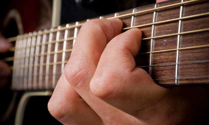 American Guitar Academy - Elsmere: $49 for Four Private Guitar Lessons with Free Lesson e-Book at American Guitar Academy ($129.95 Value)