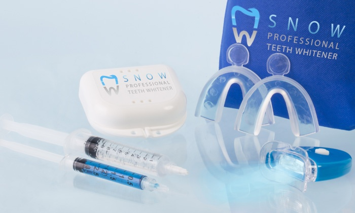 Snow Teeth Whitener - Downtown Austin: $29 for Professional Teeth Whitening Kit with Retainer Case from Snow Teeth Whitener ($199 Value)