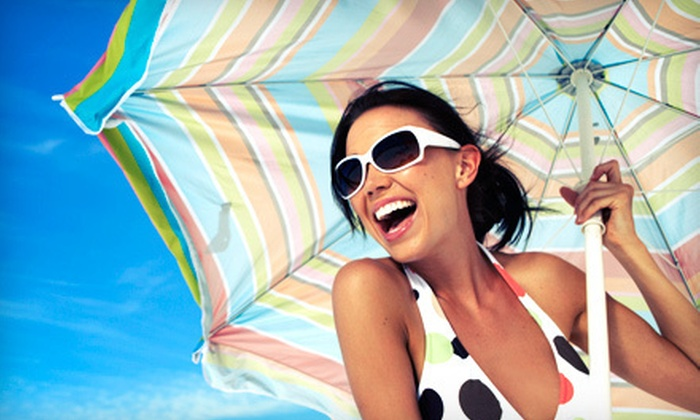 Island Tan - Laguna Niguel: One or Three Custom Airbrush Tans, or One Month of Unlimited Gold Tanning at Island Tan Salon (Up to 67% Off)