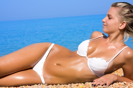 A Custom Airbrush Tanning Session at BOMBSHELL BRIDAL AND SPA (67% Off)