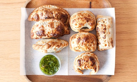 Handmade Empanadas with Sauces at 5411 Empanadas (Up to 44% Off). Four Options Available.