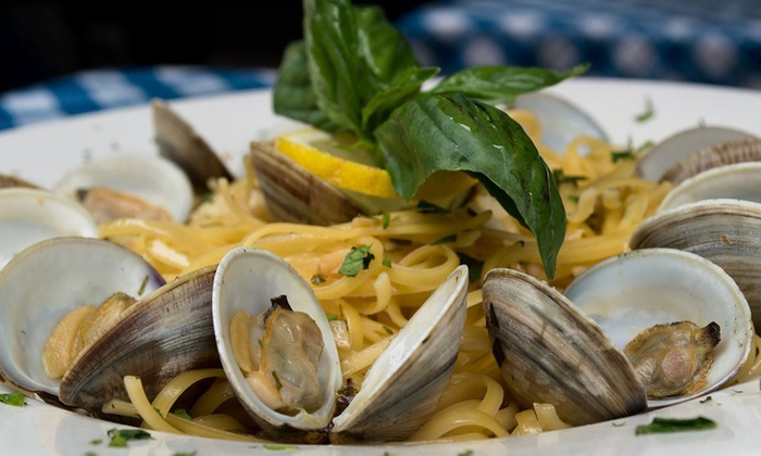 Umberto's Clam House - Little Italy: Seafood Dinner with Wine and Dessert for Two or Four at Umberto's Clam House (Up to 66% Off)