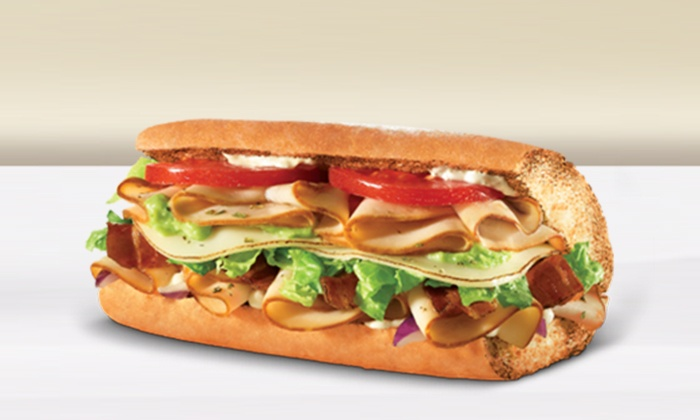 Quiznos - Nick & Moes - Lakeland: $12 for Two Groupons, Each Good for $10 Worth of Sandwiches, Subs and Wraps at Quiznos ($20 Total Value)