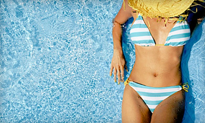 ProTan Spa - Multiple Locations: Three of Five VersaSpa Spray Tans witth One Month of Unlimited UV Tanning in Level 2 Bed at ProTan Spa (Up to 79% Off)