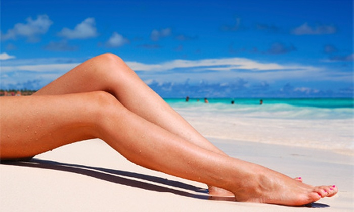 NY Sun Club - Multiple Locations: $25 for 7 Days of Unlimited UV Tanning, 3 Mystic HDs, or 1 Organic Airbrush Tan at NY Sun Club (Up to $175 Value)