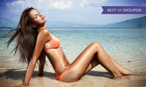 The Tidy Shoppe: One Airbrush Tan with Optional Brazilian Wax or Three Airbrush Tans at The Tidy Shoppe (Up to 49% Off)