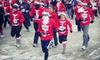 Santa Hustle - Downtown Indianapolis: Santa Hustle 5K or Half Marathon on Sunday, December 16, at 9 a.m. (Up to 43% Off)