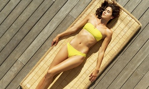 Caribbean Beach Club: One Month of Unlimited Bed Tanning or One or Three Organic Airbrush Tans at Caribbean Beach Club (Up to 57% Off)