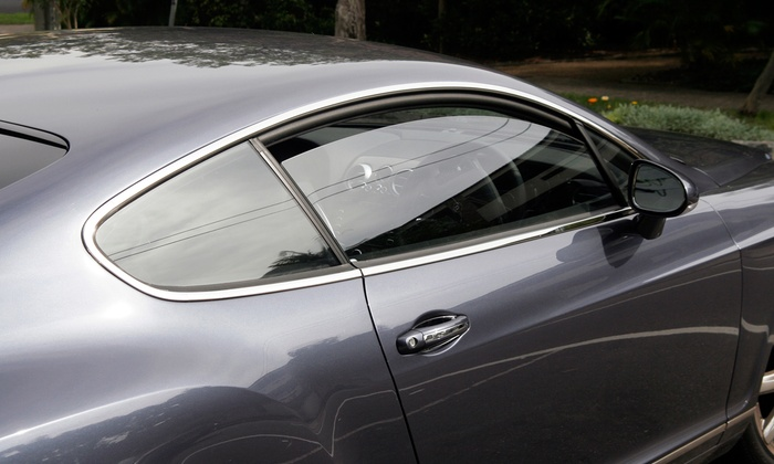 Sound Solutions - West Salem: Window Tinting a Midsize Sedan or SUV from Sound Solutions (52% Off). Four Options Available.