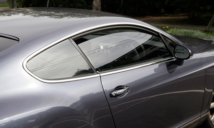 Window Tinting a Midsize Sedan or SUV from Sound Solutions (52% Off). Four Options Available.
