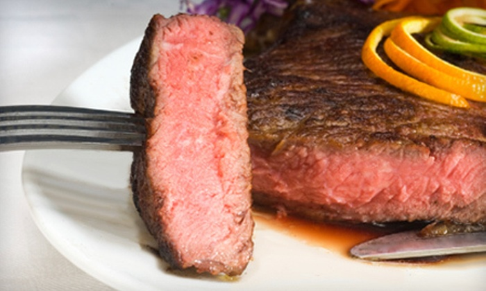 Cast Iron Steak House - Jeffersonville: Steak, Seafood, and American Fare for Two or Four at Cast Iron Steak House in Jeffersonville (Half Off)