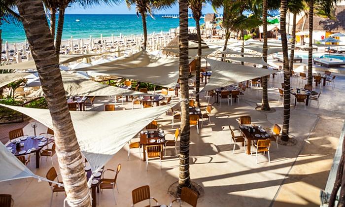 Vacation at Tukan Hotel & Beach Club with Air from Vacation Express