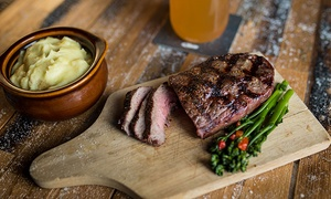 Steel Creek: $14 for $30 Worth of Steaks and Comfort Food for Dinner for Two at Steel Creek