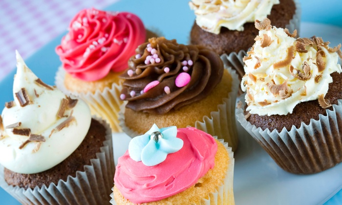 Lovee's Cakes - Layton: $14.89 for 12 LargeVanilla, Chocolate, or Flavors of the Day Gourmet Cupcakes at Lovee's Cakes ($27.99 Value)