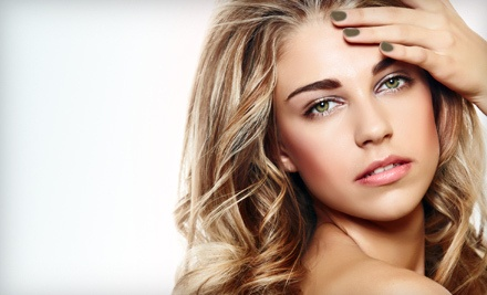 Haircut Package with Optional Color or Partial Highlights, or a Keratin Treatment at Raymar Day Spa (Up to 67% Off)