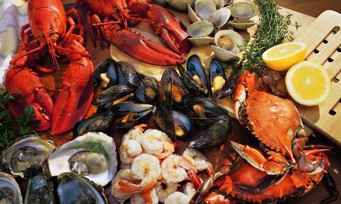 Cy's King Crab Oyster Bar & Grill - Central Chicago: $17 for $30 Worth of Seafood for Dinner for Two or More at Cy's King Crab Oyster Bar & Grill