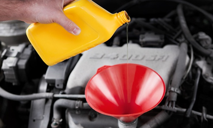 null - Multiple Locations: Oil Change, a Tire Rotation, and Inspection, a Coolant Flush, or a Fuel Injection at Total Car Care (Up to 64% Off)