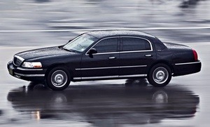 All Time Limo: One-Way or Round-Trip Airport Transportation in a Limousine or SUV from All Time Limo (50% Off)