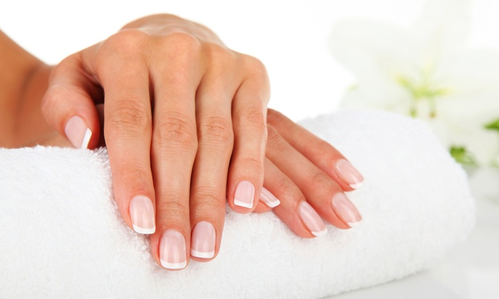 ID Beauty Salon - London: Manicure or Pedicure With Glass of Bubbly from £9.95 at ID Beauty Salon