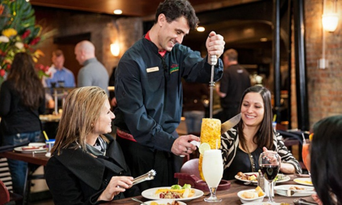 FENIX MILWAUKEE, LLC DBA Rodizio Grill - Juneau Town: Brazilian Steakhouse Dinner with Wine for Two or Four at Rodizio Grill (Up to Half Off)