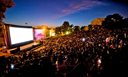 $14 for Two Admissions to an Outdoor Movie Screening from Eat|See|Hear ($24 Value). 18 Movies and Dates.