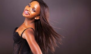 Vogue Expressions Salon Studio: Cut and Shampoo, Basic Style and Highlights, or Silk Press-Out at Vogue Expressions Salon Studio (Up to 52% Off)
