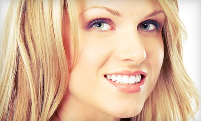 Dental Center of the Carolinas - Clemmons: One or Two Dental Implants with Porcelain Crowns at Dental Center of the Carolinas (Up to 58% Off)