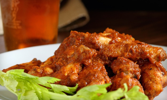 Poppy's Time Out Sports Bar & Grill - Central Business District: $15 for $30 Worth of Pub Cuisine and Drinks at Poppy's Time Out Sports Bar & Grill