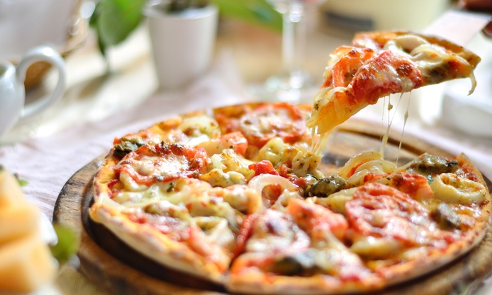 Armand's Pizzeria - Ukrainian Village: $12 for $20 Worth of Pizzeria Food for Dinner or Lunch at Armand's Pizzeria.