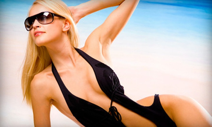 Amazing Tans - Multiple Locations: One or Three Months of Unlimited UV Tanning or Three Spray Tans at Amazing Tans (Up to 67% Off)