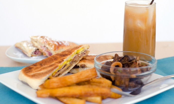 Coco Cabana - Tucker: Cuban Dinner for Two or Four at Coco Cabana (Up to 58% Off)