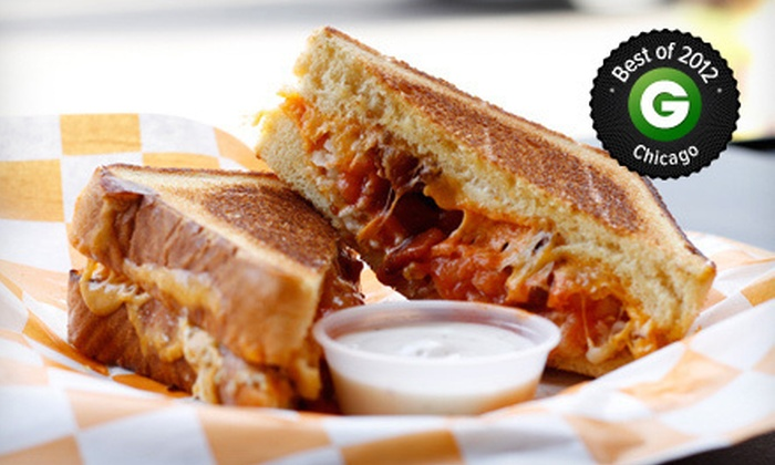 Cheesie's Pub & Grub - Lakeview: $19 for Grilled Cheese Sandwiches, Soups, Side, and Drinks for Two at Cheesie's Pub & Grub ($38 Value)