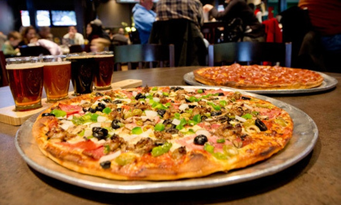Village Inn Pizza and Sports Grille - Millbrook: $15 for $30 Worth of Pub Cuisine and Drinks at Village Inn Pizza and Sports Grille